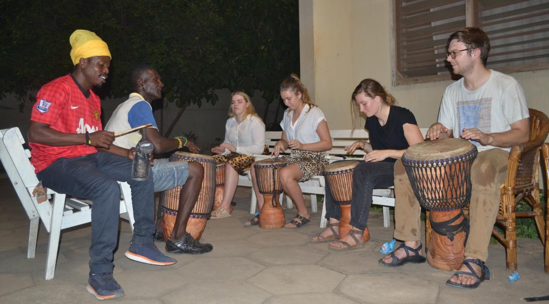 A group of Projects Abroad teaching volunteers learn local music in Ghana.
